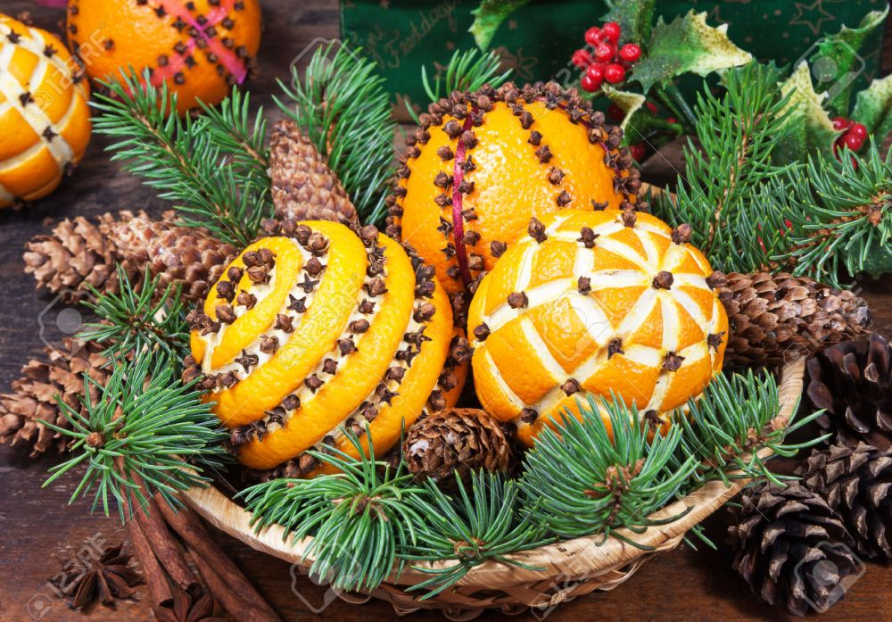 Christmas decoration with oranges in the basket and fir tree